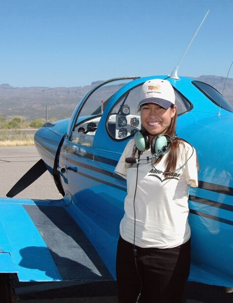 Jessica Cox with a blue airplane