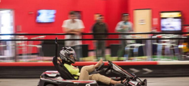 Jessica Cox driving go kart