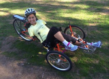 Jessica Cox on a 3 wheel bicycle