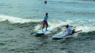 Jessica Cox surfing