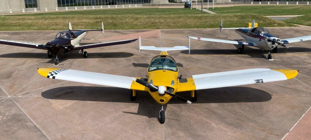 N26R and two Ercoupe airplanes parked on ramp